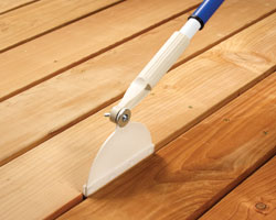 Crack and Groove Tools paint and stain between deck and fence boards