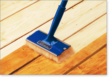 The Deck & Fence Stain Pad carries more stain to the deck surface