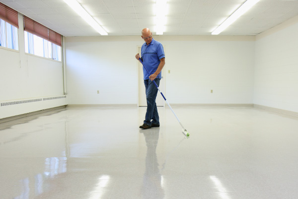 Padco Floor Coater applying wax to vinyl floor