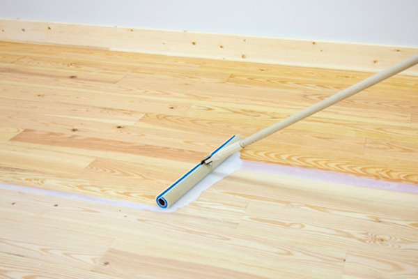 Padco Floor Finish Applicator on a residential hardwood floor